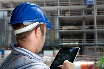Depositphotos_Construction-specialist-using-tablet_6600063_l